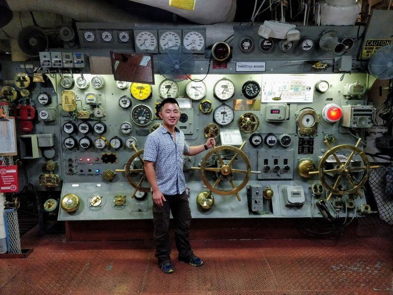 Eric Lu works on a project at the USS Midway during his SPAWAR internship